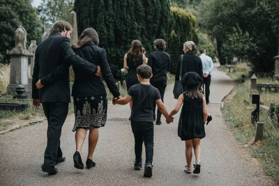 A family walk away after a funeral